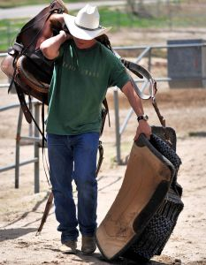 The cowboy carries all he needs with him - that's a heavy load at times